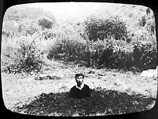 Keith Arnatt, from Self-Burial in 9 photographs, courtesy MediaArtNet.org